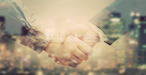 Double exposure of business people handshake on big city background  Stock photo © photocreo