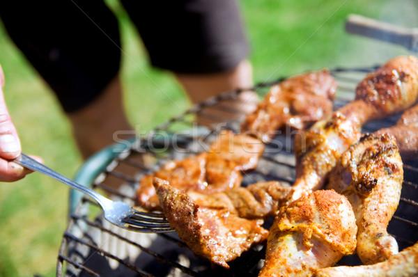 Barbecue főzés barbecue grill étel fű férfi Stock fotó © photocreo