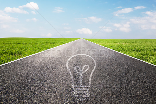 Light bulb symbol on long empty straight road. Environment, idea Stock photo © photocreo