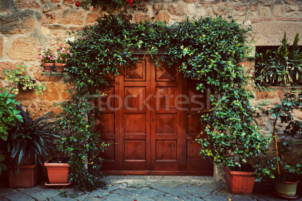 Retro wooden door outside old Italian house in a small town of Pienza, Italy. Vintage Stock photo © photocreo