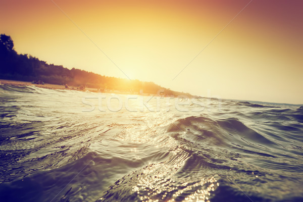 Sea waves and ripples at sunset. First person perspective swimming Stock photo © photocreo