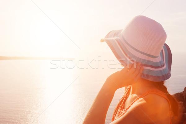 Happy woman in sun hat enjoying the sea view. Santorini, Greece Stock photo © photocreo