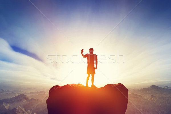Man taking a picture, selfie with his smartphone in mountains. Mobile photography Stock photo © photocreo