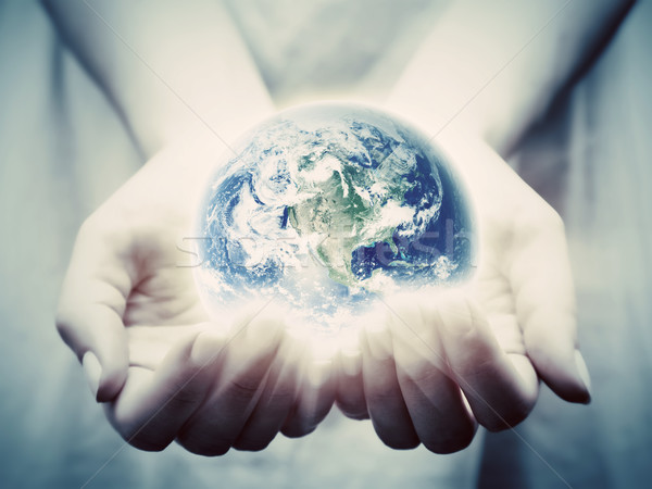 The earth shines in young woman hands. Save the world Stock photo © photocreo