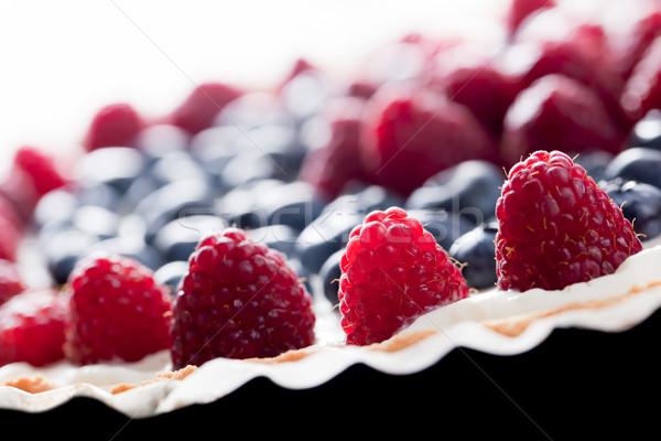 Fruit tart with fresh raspberry and blueberry. Morning light Stock photo © photocreo