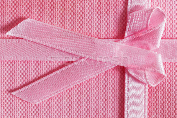 Pink gift box with tied ribbon Stock photo © photocreo