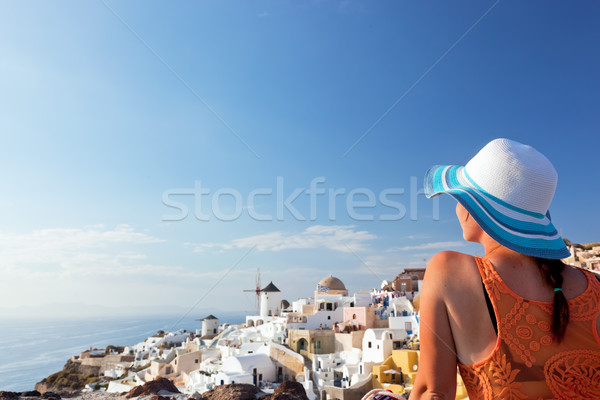 Happy tourist woman on Santorini island, Greece. Travel Stock photo © photocreo