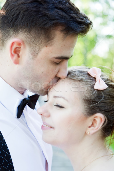 Young handsome man gently kissing his fiancee. Love Stock photo © photocreo