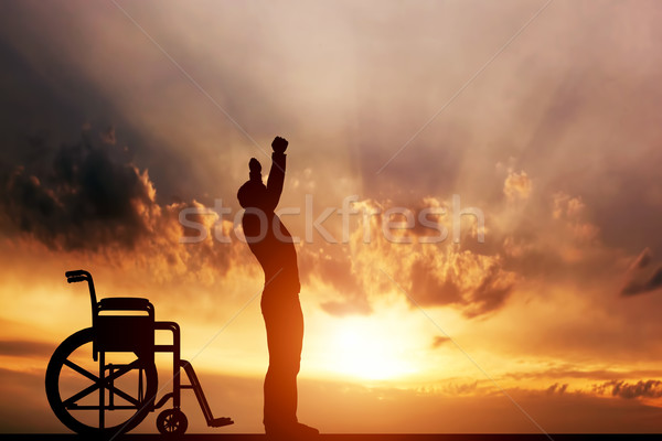 A disabled man standing up from wheelchair. Cure, medical miracle. Stock photo © photocreo