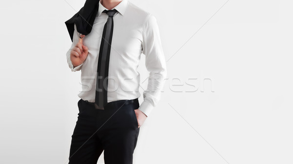 Businessman in laid-back, relaxed pose on white background. Stock photo © photocreo