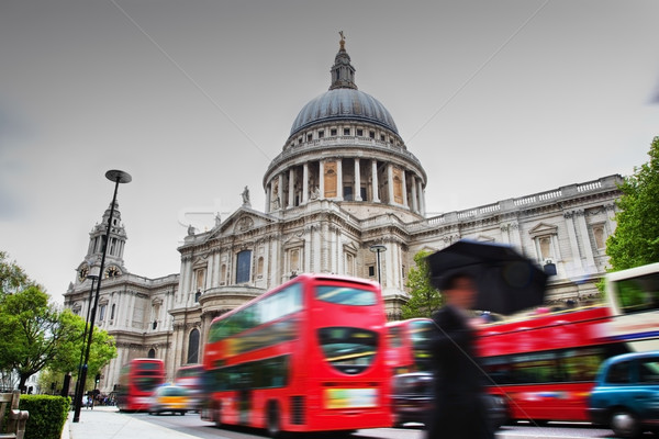 St Paul's Cathedral in London, the UK. Red buses in motion Stock photo © photocreo