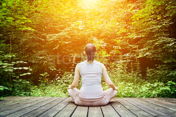 Young woman meditating in a forest. Zen, meditation, healthy breathing Stock photo © photocreo