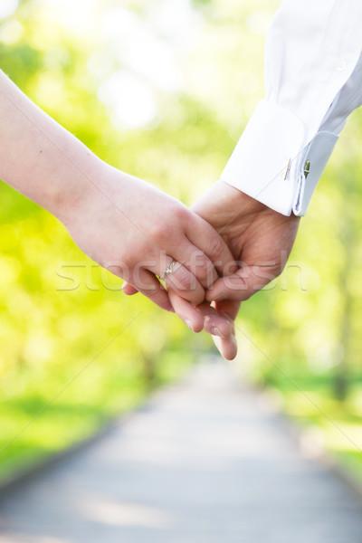 Kéz a kézben közelkép pár szeretet randizás nyár Stock fotó © photocreo
