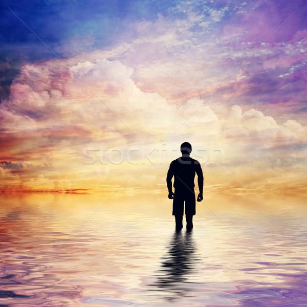 Homme eau calme océan regarder conte de fées Photo stock © photocreo