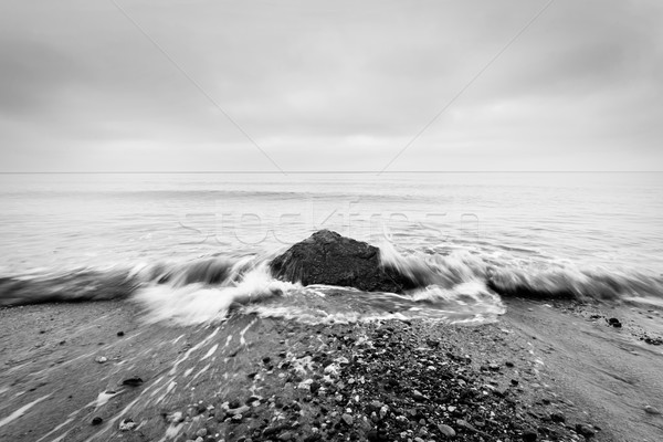 Nostalgic sea. Waves hitting in rock in the center. Black and white Stock photo © photocreo