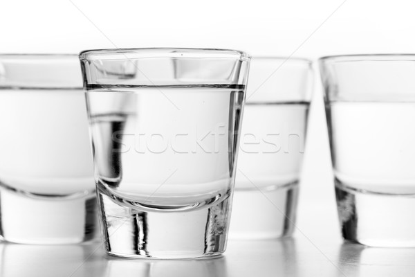 Glasses of vodka on white background. Alcohol Stock photo © photocreo