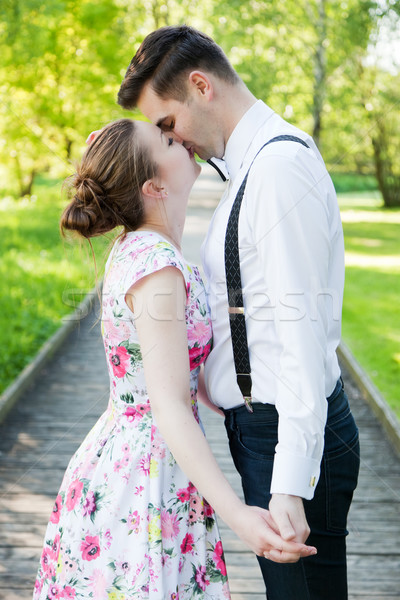 Young couple in love together, holding hands. Stock photo © photocreo