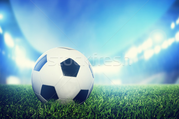 Football, soccer match. A leather ball on grass on the stadium Stock photo © photocreo