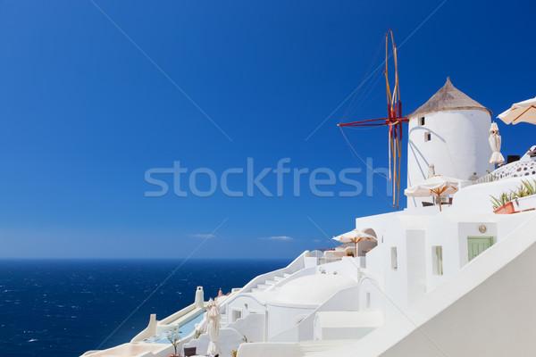 Oia town on Santorini island, Greece.  Famous windmills Stock photo © photocreo