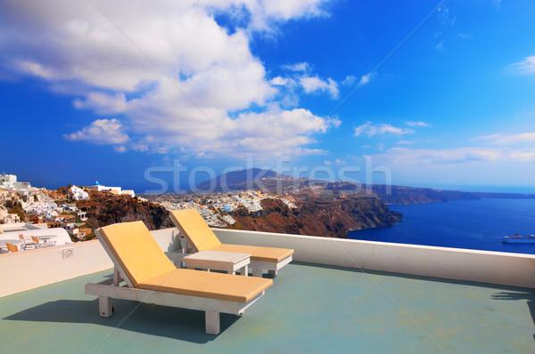 Two deckchairs on the roof. Santorini island, Greece Stock photo © photocreo
