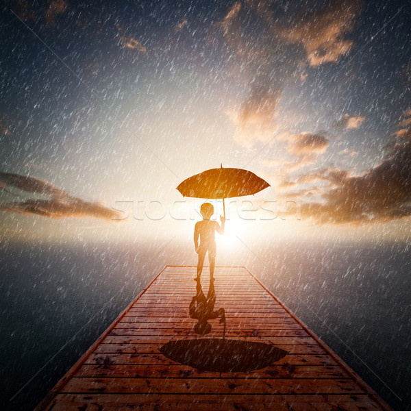 Child with umbrella standing alone wooden jetty in rain looking at the sea.  Stock photo © photocreo