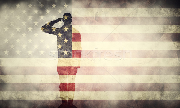 Double exposure of saluting soldier on USA grunge flag. Patriotic design Stock photo © photocreo