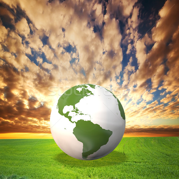 Planet Earth model on green field at sunset Stock photo © photocreo