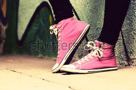 Close up of pink sneakers worn by a teenager. Stock photo © photocreo