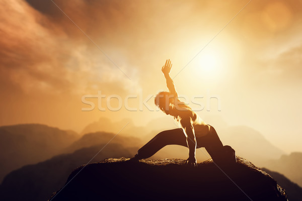Asian man, fighter practices martial arts in high mountains at sunset. Stock photo © photocreo