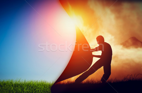 Man pulling curtain of darkness to reveal a new better world. Change. Stock photo © photocreo
