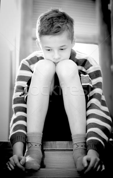 Smutek portret młody chłopak posiedzenia twarz dziecko Zdjęcia stock © photocreo