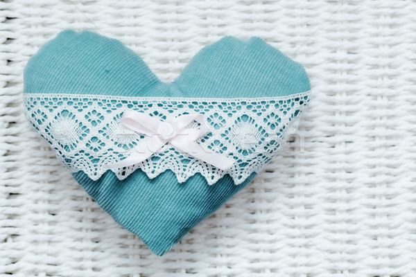 Vintage handmade plush turquoise heart on white rustic wicker Stock photo © photocreo