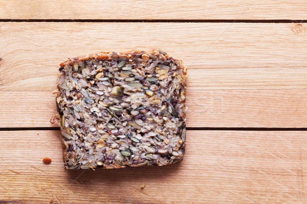 Wholemeal, wholewheat slice of bread on wooden table. Organic, healthy food Stock photo © photocreo