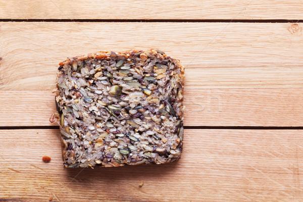 Teljeskiőrlésű szelet kenyér fa asztal organikus egészséges étel Stock fotó © photocreo