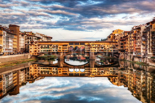 Ponte Vecchio bridge in Florence, Italy. Arno River under romantic sky Stock photo © photocreo