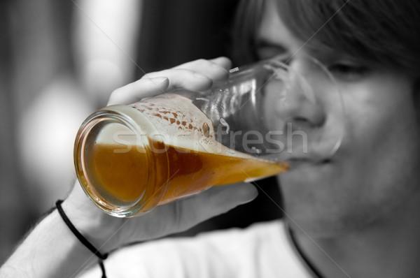 Teenager drinking beer Stock photo © photocreo