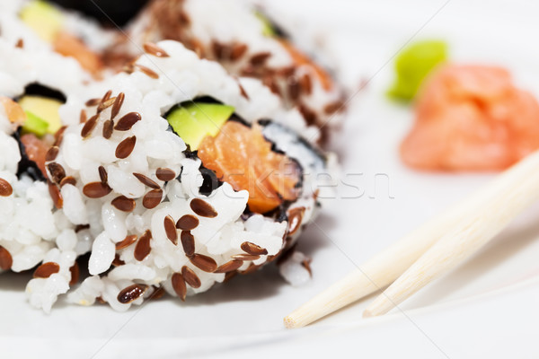 Sushi with salmon, avocado, rice in seaweed served with wasabi and ginger.  Stock photo © photocreo