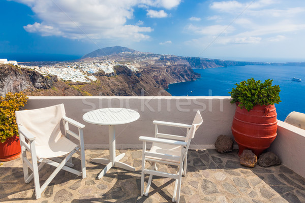 Table and chairs on roof with a panorama view on Santorini island, Greece. Stock photo © photocreo