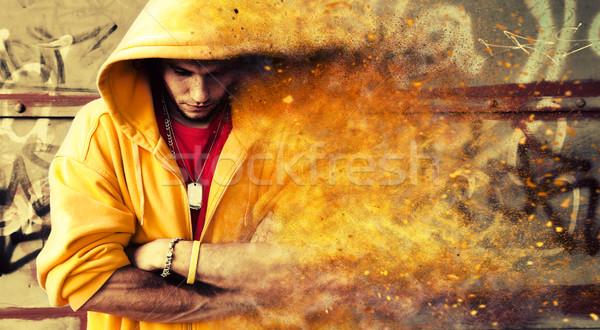 Młody człowiek grunge ściany cząstki Zdjęcia stock © photocreo