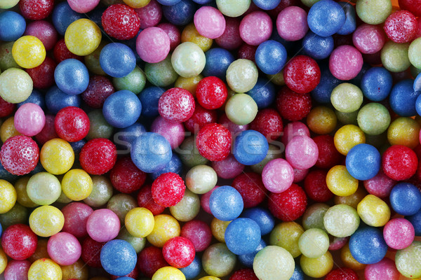 Colorful sweet sugar pearls decoration close-up background, pattern. Stock photo © photocreo