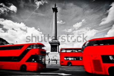 Trafalgar Square in London, the UK. Red bus, black and white Stock photo © photocreo