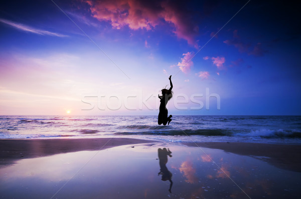 Happy jump jumping on beach Stock photo © photocreo