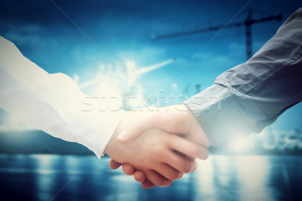 Business handshake in shipyard. Industry, deal, contract. Stock photo © photocreo