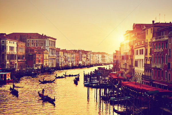 Venice, Italy. Gondolas on Grand Canal at gold sunset. Vintage Stock photo © photocreo