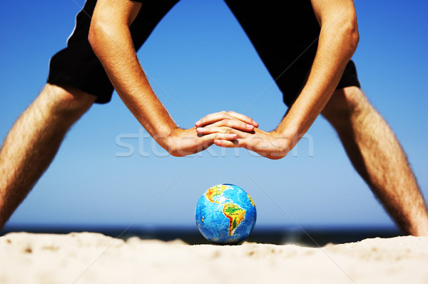 Earth globe with hands over it. Conceptual image Stock photo © photocreo