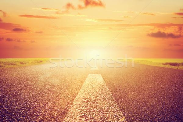 Longtemps vide asphalte route coucher du soleil soleil Photo stock © photocreo