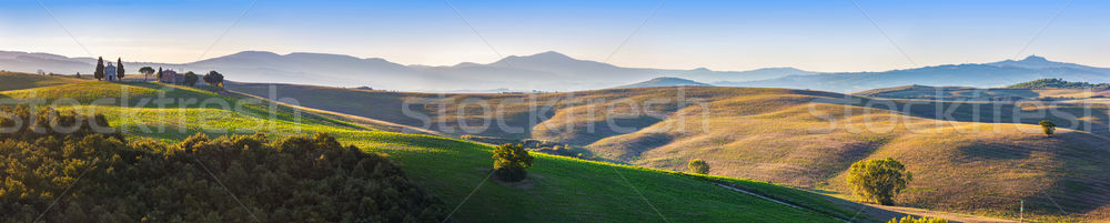 Tuscany landscape panorama at sunrise with a chapel of Madonna d Stock photo © photocreo