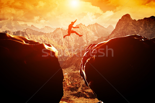 Man jumping over precipice Stock photo © photocreo