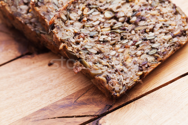 Wholemeal, wholewheat bread on wooden table. Organic, healthy food Stock photo © photocreo