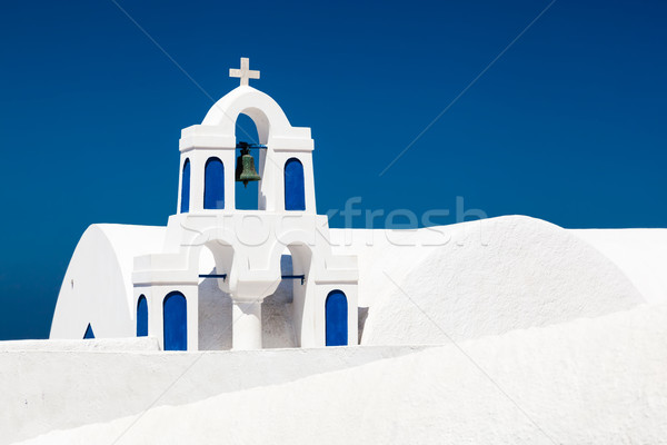 A white church with blue elements in Oia on Santorini island, Greece. Stock photo © photocreo